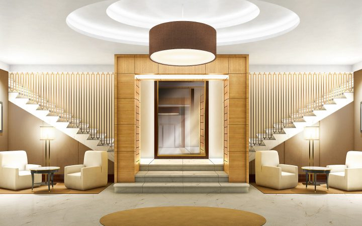Kronprinzengärten • Wohnhaus 7-8 • Ein warmer Empfang: der repräsentative Foyerbereich mit Natursteinbelägen und textilen Wandbespannungen